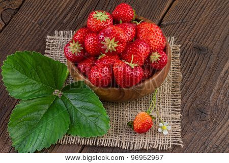 Strawberries in Wooden Bowl on Canvas Background