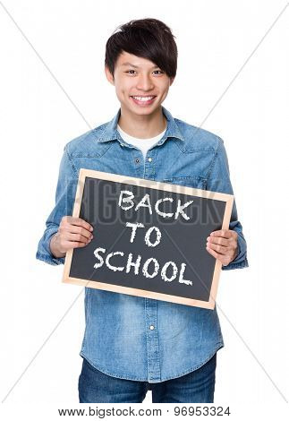 Asian young man with chalkboard showing phrases of back to school