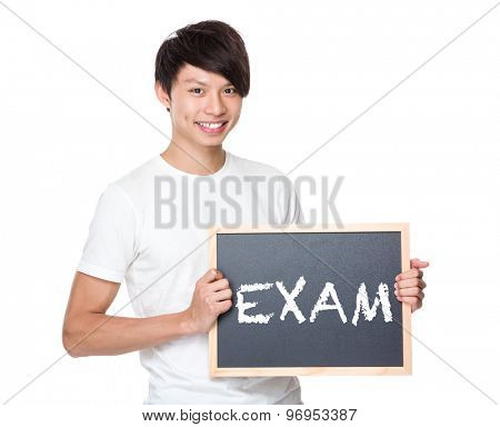 Young university student with blackboard showing a word exam