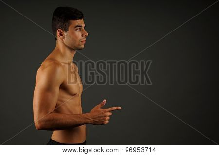 Young man  pointing ahead