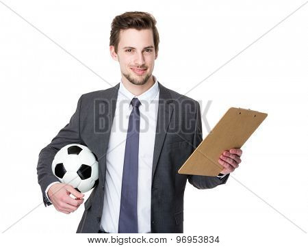 Soccer manager hold with soccer ball and clipboard