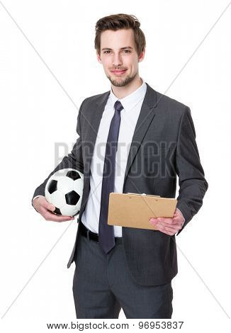 Football trainer hold with soccer ball and clipboard