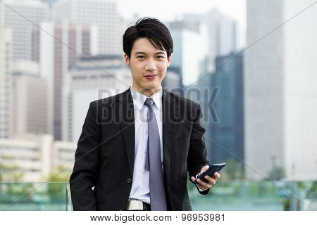 Businessman with cell phone in cbd