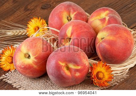 Ripe peaches on wooden background
