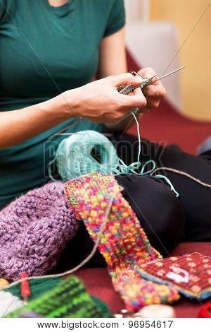 Closeup Of A Knitting Female