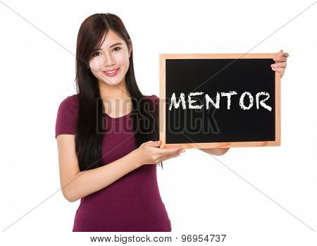 Asian woman hold with the blank chalkboard showing a word mentor