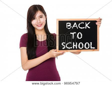 Asian woman hold with the blank chalkboard showing phrase of back to school