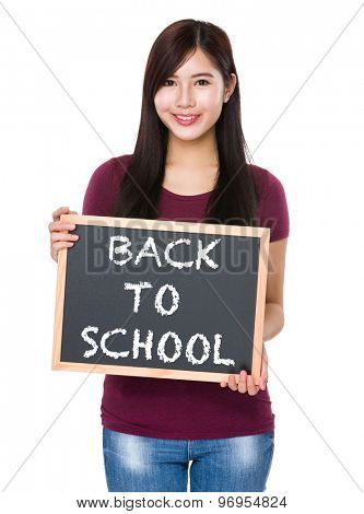 Asian woman with chalkboard showing phrase of back to school