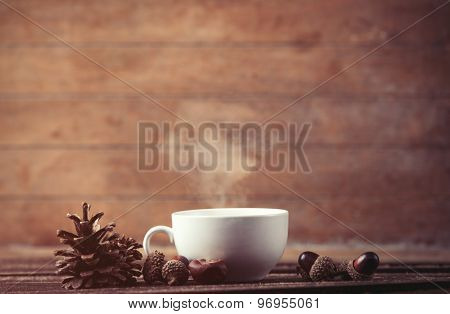 Cup Of Coffee And Pine Cone With Acorns