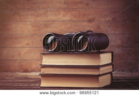 Black Binocular And Books