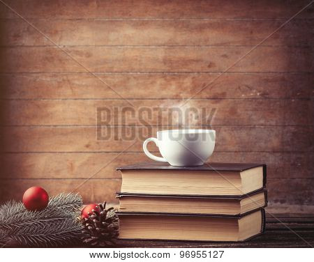 Cup Of Tea With Christmas Tree Brench And Books