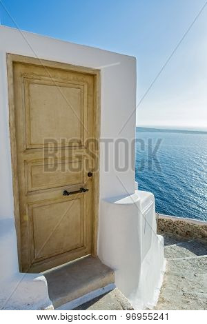 Stairs And Door Which Go Down To Sea Of Santorini