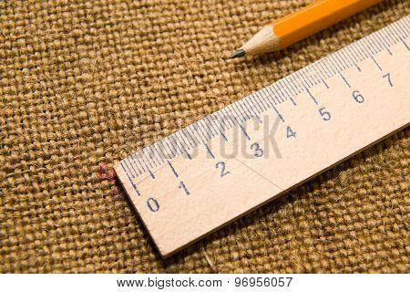 Wooden Pencil Drawing And Wooden Ruler On The Old Tissue