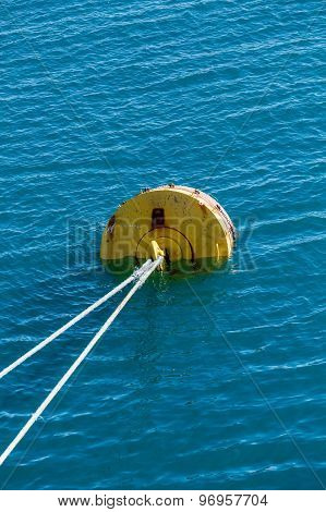 White Rope To Yellow Mooring In Blue Water