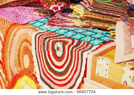 Store Fabric Counter With Multicolored Rugs.