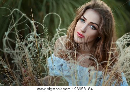Portrait Of A Girl In Dry Grass.