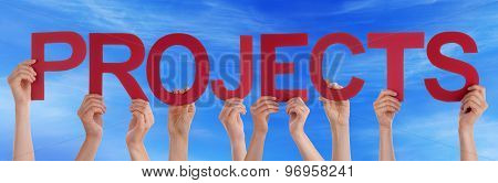 Many People Hands Holding Red Straight Word Projects Blue Sky