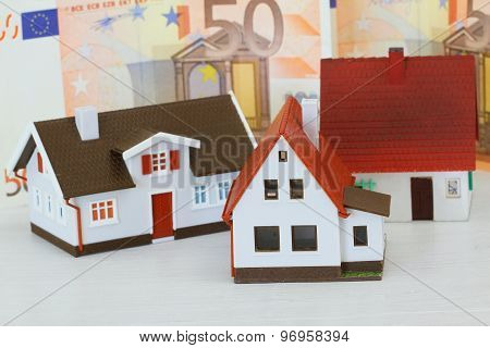 Model houses with Euro banknotes in the background