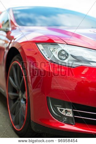 Close-up View Of Red Sports Car Headlight.