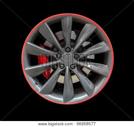 Sports Car Rim Isolated On Black Background.
