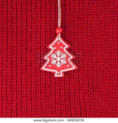 Christmas Tree Decoration over Red Wool Fabric