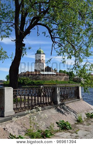 VYBORG, LENINGRAD OBLAST, RUSSIA - JUNE 6, 2015: View to the embankment and the tower of St. Olav of Vyborg Castle. The castle was founded in 1293