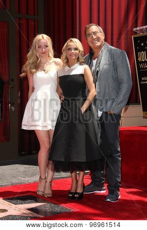 LOS ANGELES - JUL 24:  Dove Cameron, Kristin Chenoweth, Kenny Ortega at the Kristin Chenoweth Hollywood Walk of Fame Star Ceremony at the Hollywood Blvd on July 24, 2015 in Los Angeles, CA