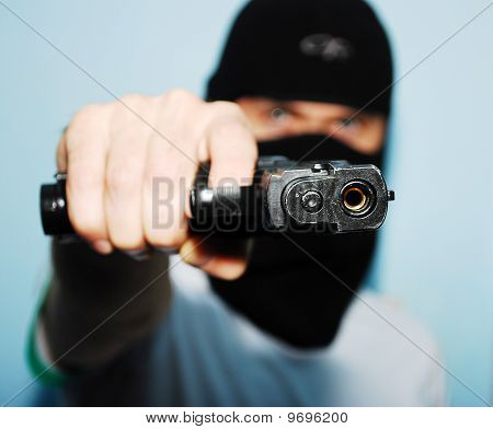 Man With A Gun On His Hand