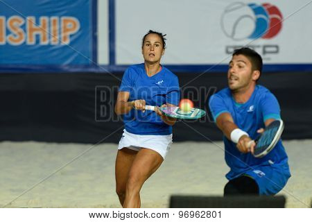 MOSCOW, RUSSIA - JULY 19, 2015: Federica Bacchetta (center) and Marco Garavini of Italy in the final match of the Beach Tennis World Team Championship against Russia. Italy become world champion