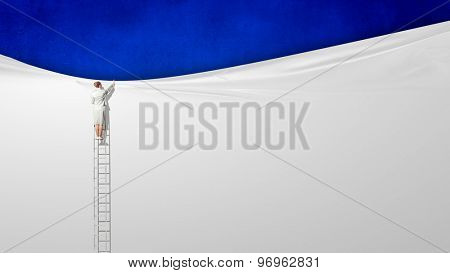 Rear view of businesswoman standing on ladder. Place for text