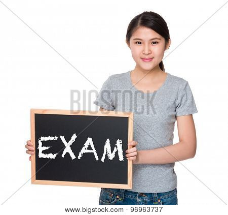 Young woman with the blackboard and showing a word exam