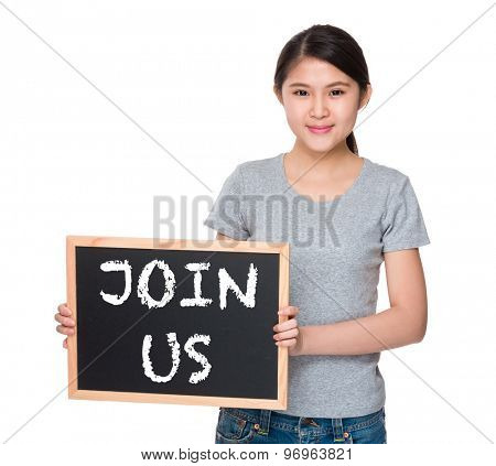 Young woman with the blackboard and showing phrase join us