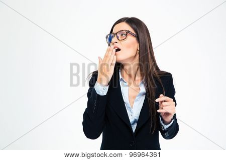 Businesswoman yawning isolated on a white background