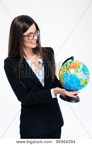 Happy businesswoman holding globe isolated on a white background