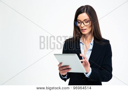 Beautiful businesswoman using tablet computer isolated on a white background