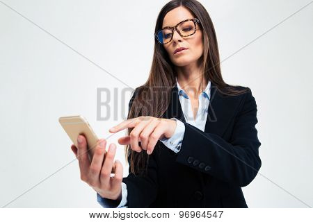 Businesswoman using smartphone isolated on a white background