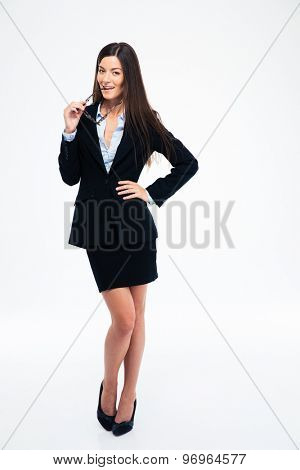 Full length portrait of a beautiful businesswoman standing isolated on a white background. Looking at camera