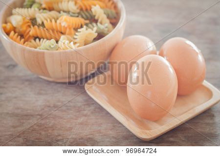 Fresh Eggs On Wooden Plate With Fusili
