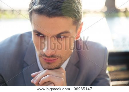 Portrait of a pensive businessman outdoors