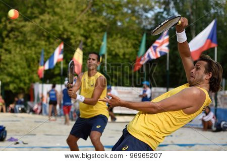 MOSCOW, RUSSIA - JULY 17, 2015: Vinicius Font (in front) and Thales Santos of Brazil in the quarterfinal match of the Beach Tennis World Team Championship against France. Brazil won the match