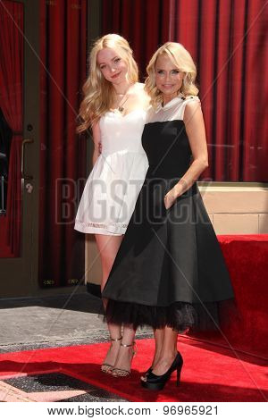 LOS ANGELES - JUL 24:  Dove Cameron, Kristin Chenoweth at the Kristin Chenoweth Hollywood Walk of Fame Star Ceremony at the Hollywood Blvd on July 24, 2015 in Los Angeles, CA