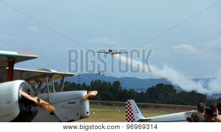 Thiene, Vicenza - Italy. 26Th July, 2015: Acrobatic Exhibition Of Antique Aircraft With Engine Smoke