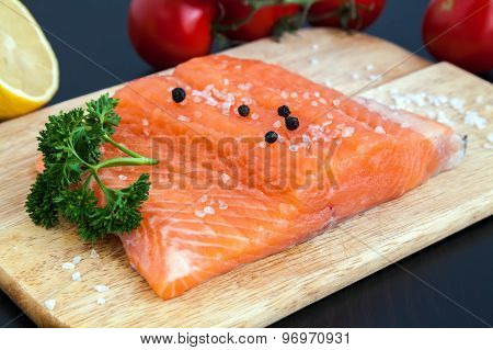 Raw Salmon Fillet With Salt, Pepper And Parsley
