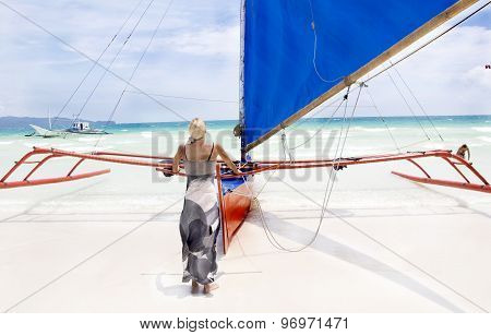 Young beautiful woman on sail boat in Boracay