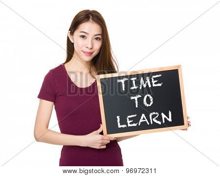 Young woman with blackboard showing phrase time to learn