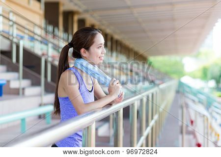 Happy girl take a break after running in sport arena