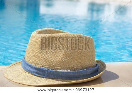 Straw Hat By The Pool