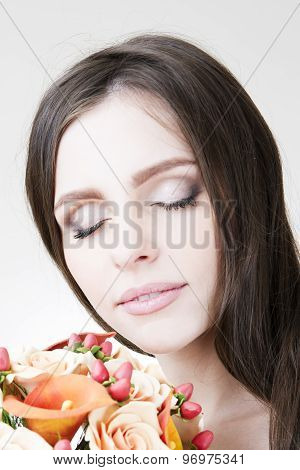 Studio Portrait Of A Young Beautiful Bride. Professional Make-up And Hairstyle