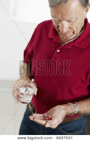 Senior Man Taking Medicine