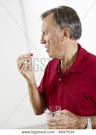 Senior Man Eating Pills